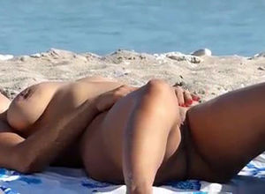 Nudist main sunbathing lay bare..