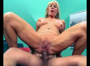 This platinum-blonde mature lady was..