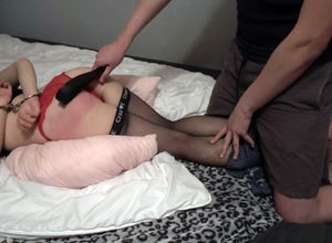 Bondaged doll sub smacked with a belt..