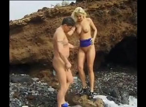 Ash-blonde model urinating on her beau
